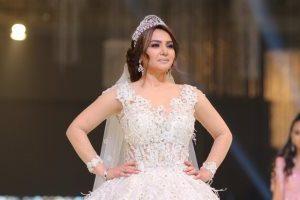 دينا فؤاد تلف الأنظار لها بفستان زفاف 2019 بأحد عروض الأزياء